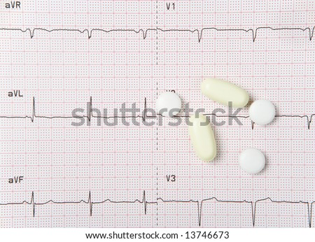 An electrocardiogram, or EKG, with heart pills.