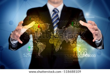 An elegant analytics person holding map of the world in its hand with numbers, statistics in front of blue background concept stock photo