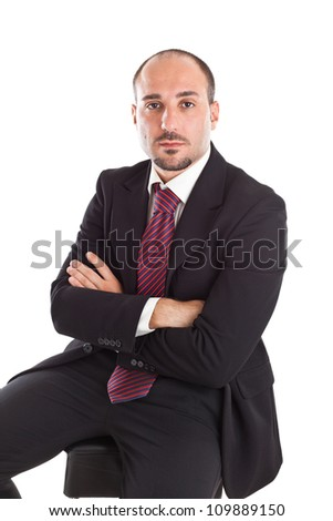 an elegant businessman sitting on a footstool