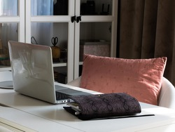 An elegant home office. On the table is a computer, a diary.