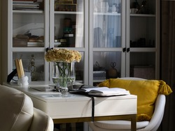 An elegant home office. On the table is a computer, an open diary
