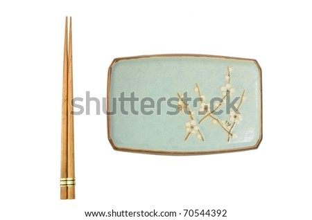 An elegant japanese plate and a pair of chopsticks