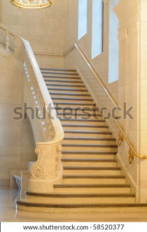 An elegant marble staircase in a venerable public building