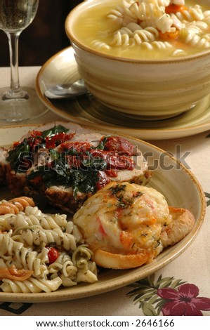 An elegant meal with crab patty melts, herbed pork, pasta and soup