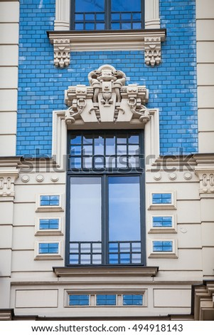 An element of facade of an Art Nouveau building with bas-relief and statues. Riga, Latvia. #494918143