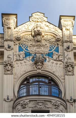 An element of facade of an Art Nouveau building with bas-relief and statues. Riga, Latvia. #494918155