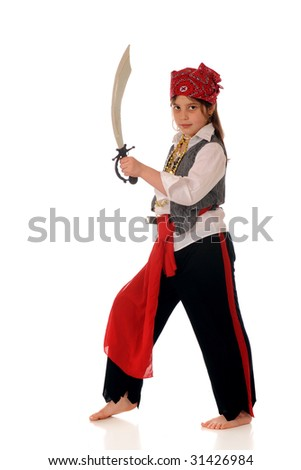 An elementary girl dresses as a pirate looking at the viewer with her sword drawn.  Isolated on white.