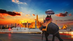 An Elephant with Tourists at Wat Phra Kaew -the Temple of Emerald Buddha- in the Grand Palace of Thailand in Bangkok