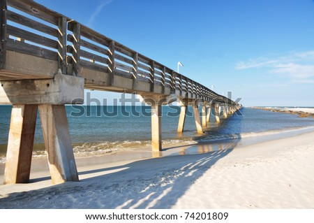 an elevated bridge projecting into the sea (Fort Clinch State Park, FL)