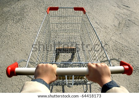 an elevated view of a single empty shopping-cart