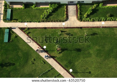 an elevated view of people walking in the garden