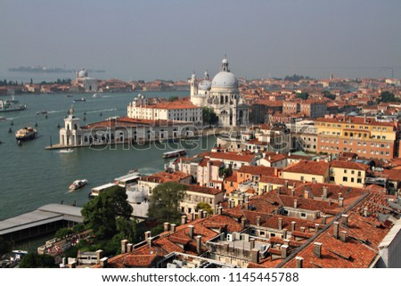 An elevated view over the rooftops and waterways of Venice, Italy.