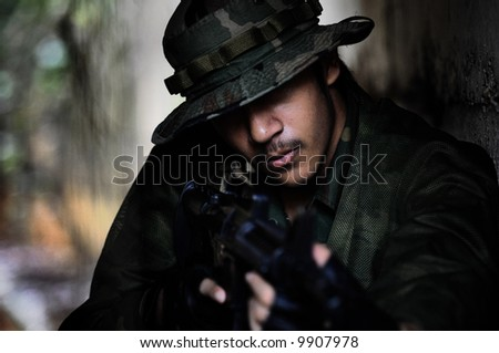 An elite force soldier hiding in the shadows