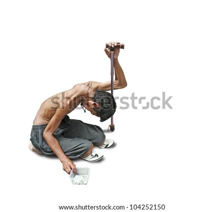 An emaciated heavily sun tan homeless beggar isolated against white.