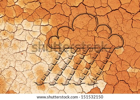 An embossed symbol of a rain cloud with falling rain on the surface of a parched crack earth for weather concept.