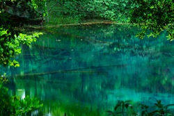 An emerald green pond filled with spring water only,yuza town,Yamagata Prefecture,japan