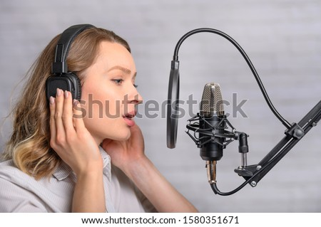 An employee of a radio station, works on the radio, or on the sound recording of film dubbing