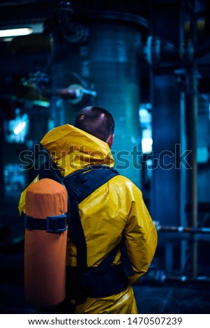 An employee of Belarusian chemical factory. Background of a chemical plant