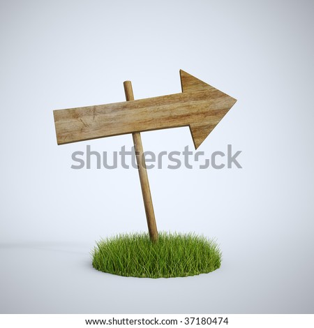 An empty arrow sign made out of wood on a patch of grass