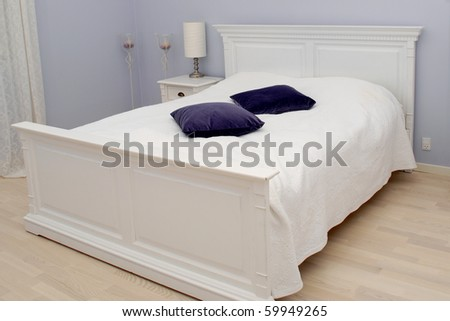 An empty bed in a bedroom.