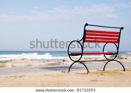An empty bench on the shore of the deserted shore