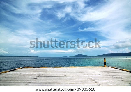 An empty boat dock on tropical beach with blue water and beautiful scenery. This picture taken in one of the most beautiful travel and diving destination on earth. Raja Ampat Island, Papua, Indonesia.