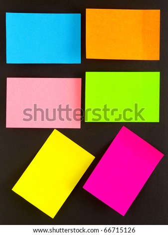 an empty color sticky notes on black - stock photo