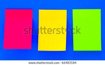 an empty color sticky notes on blue
