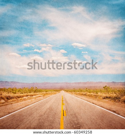 an empty desert road with paper ...