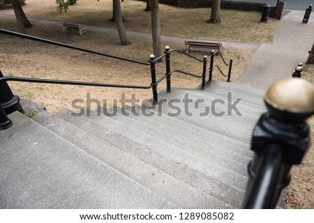 An empty French style paris style flight of stairs, with a steel metal handrail. beautiful victorian architecture, perfect for composites. compositing.  #1289085082