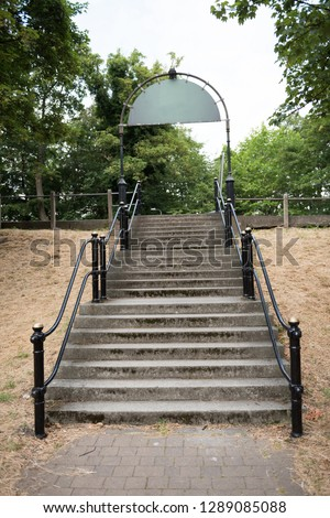 An empty French style paris style flight of stairs, with a steel metal handrail. beautiful victorian architecture, perfect for composites. compositing.  #1289085088