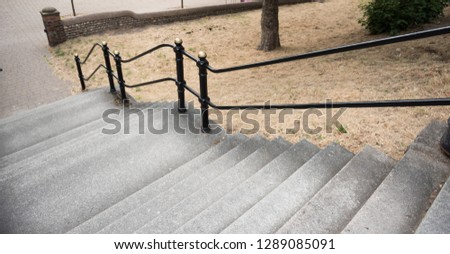 An empty French style paris style flight of stairs, with a steel metal handrail. beautiful victorian architecture, perfect for composites. compositing.  #1289085091