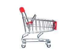 An empty grocery cart from a supermarket. There is a shortage of products in the store due to the coronavirus epidemic. Quarantine and isolation of the population in cities of many countries.