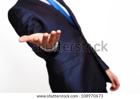 An empty hand of a businessman in blue suit