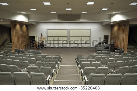 An empty lecture hall with a large amount of seats