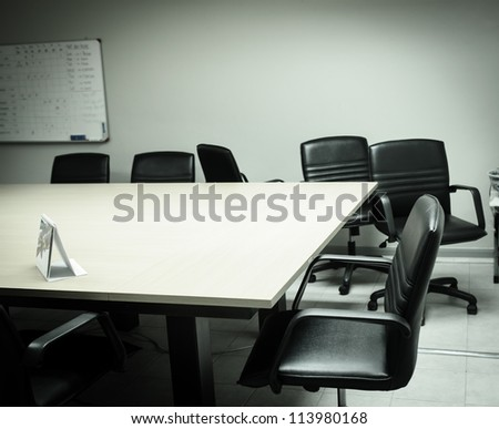 An empty meeting room and conference table, from mirror sticker