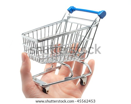 An empty miniature shopping cart held in the palm of a man's hand