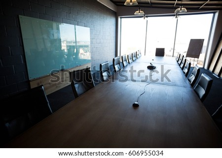 An empty modern conference room with conference table in office