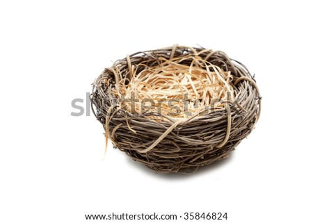 An empty nest on a white background with copy space - stock photo