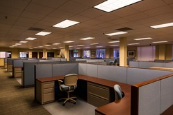 An empty office space with furnished cubicles ready to be occupied.
