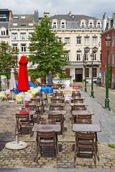 An empty patio on a quiet little plaza of Brussels, Belgium