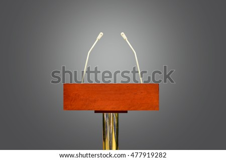 An empty podium and microphones isolated over gray background #477919282