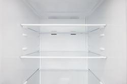 An empty refrigerator. Inside an empty, clean refrigerator, a refrigerator compartment after defrosting