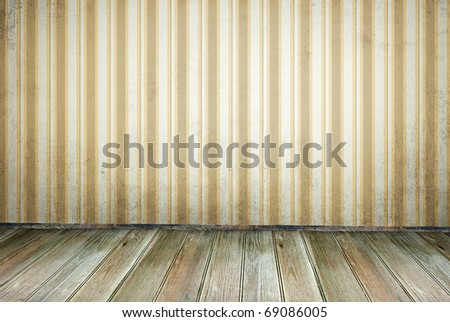 An empty room in vintage style. Dirty striped wallpaper, boards floor