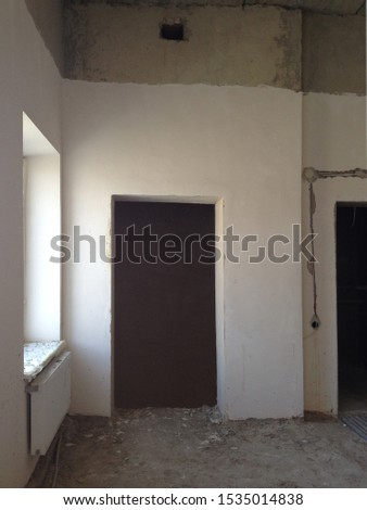 An empty room with an empty Elevator shaft opening