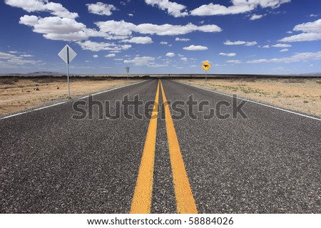 An empty rural highway in New Mexico, USA.