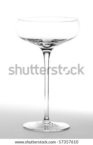 An empty saucer style champagne glass.  Studio isolated on a white background. - stock photo