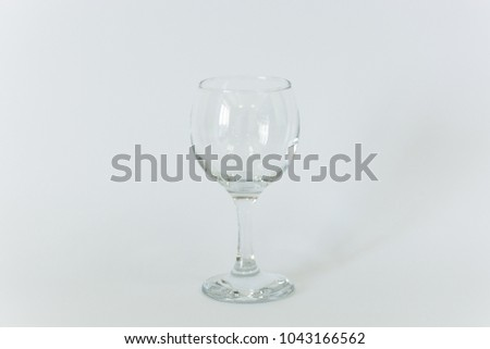 An empty sherry glass on a white background