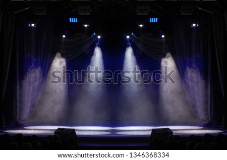An empty stage of the theater, lit by spotlights and smoke before the performance #1346368334