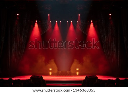 An empty stage of the theater, lit by spotlights and smoke before the performance #1346368355